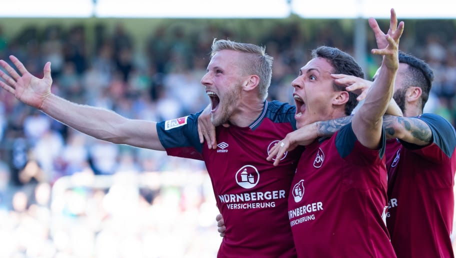 SANDHAUSEN, GERMANY - MAY 06: Hanno Behrens of Nuernberg celebrates his team's first goal with team matew Georg Margreitter during the Second Bundesliga match between SV Sandhausen and 1. FC Nuernberg at BWT-Stadion am Hardtwald on May 6, 2018 in Sandhausen, Germany. (Photo by Simon Hofmann/Bongarts/Getty Images)