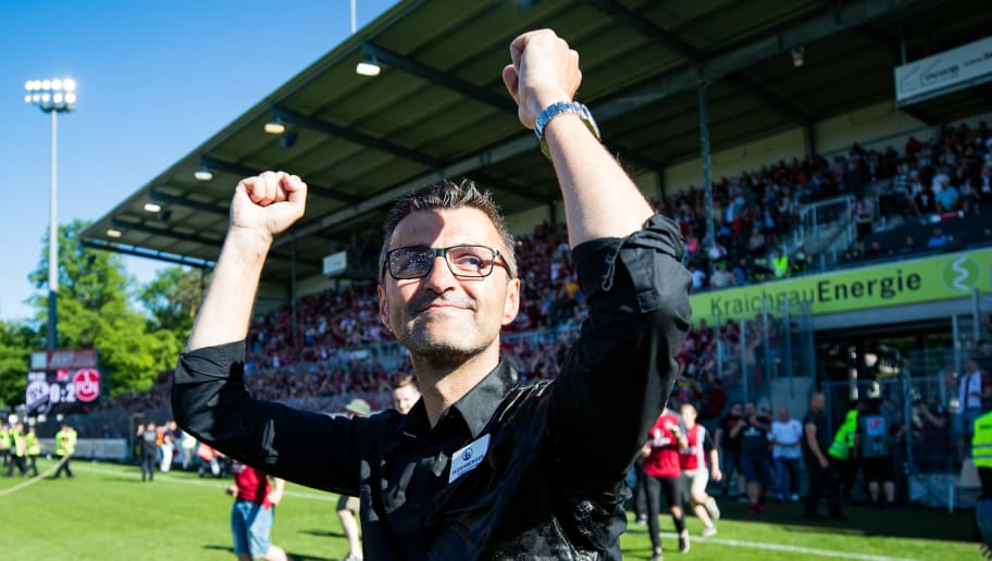 SANDHAUSEN, GERMANY - MAY 06: Head coach Michael Koellner of Nuernberg celebrates winning after the Second Bundesliga match between SV Sandhausen and 1. FC Nuernberg at BWT-Stadion am Hardtwald on May 6, 2018 in Sandhausen, Germany. (Photo by Simon Hofmann/Bongarts/Getty Images)
