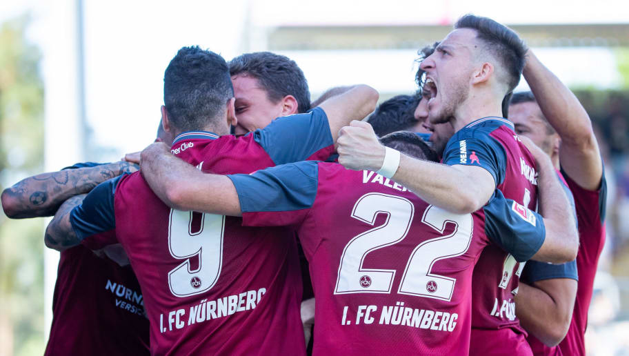SANDHAUSEN, GERMANY - MAY 06: Team mates  of Nuernberg celebrate their first goal during the Second Bundesliga match between SV Sandhausen and 1. FC Nuernberg at BWT-Stadion am Hardtwald on May 6, 2018 in Sandhausen, Germany. (Photo by Simon Hofmann/Bongarts/Getty Images)