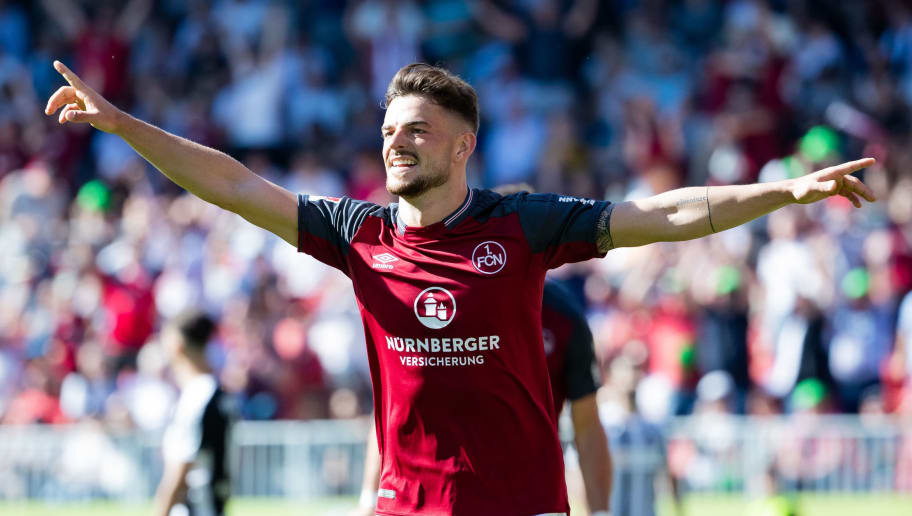 SANDHAUSEN, GERMANY - MAY 06: Tim Leibold of Nuernberg celebrates his team's second goal during the Second Bundesliga match between SV Sandhausen and 1. FC Nuernberg at BWT-Stadion am Hardtwald on May 6, 2018 in Sandhausen, Germany. (Photo by Simon Hofmann/Bongarts/Getty Images)