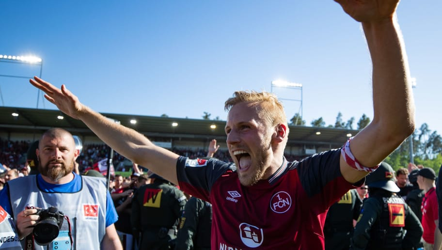 SANDHAUSEN, GERMANY - MAY 06: Hanno Behrens of Nuernberg celebrates winning after the Second Bundesliga match between SV Sandhausen and 1. FC Nuernberg at BWT-Stadion am Hardtwald on May 6, 2018 in Sandhausen, Germany. (Photo by Simon Hofmann/Bongarts/Getty Images)