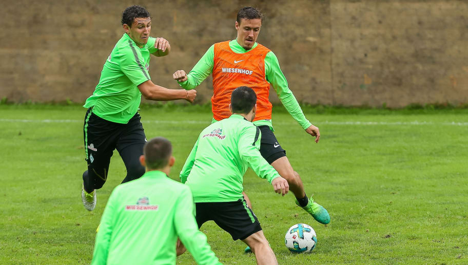 ZELL AM ZILLER, AUSTRIA - JULY 14: Milos Veljkovic of Werder Bremen and Max Kruse of Werder Bremen battle for the ball during the Training Camp of SV Werder Bremen on July 14, 2017 in Zell am Ziller, Austria. (Photo by TF-Images/TF-Images via Getty Images)