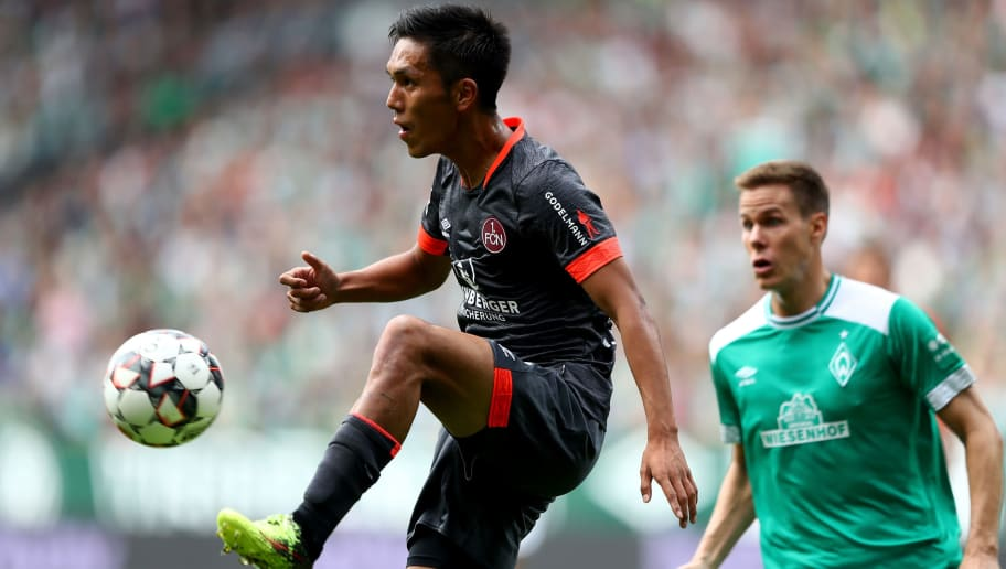 BREMEN, GERMANY - SEPTEMBER 16:  Yuya Kubo of Nuernberg runs with the ball during the Bundesliga match between SV Werder Bremen and 1. FC Nuernberg at Weserstadion on September 16, 2018 in Bremen, Germany.  (Photo by Martin Rose/Bongarts/Getty Images)