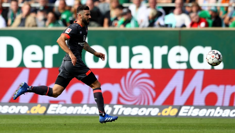 BREMEN, GERMANY - SEPTEMBER 16:  Mikael Ishak of Nuernberg runs with the ball during the Bundesliga match between SV Werder Bremen and 1. FC Nuernberg at Weserstadion on September 16, 2018 in Bremen, Germany.  (Photo by Martin Rose/Bongarts/Getty Images)