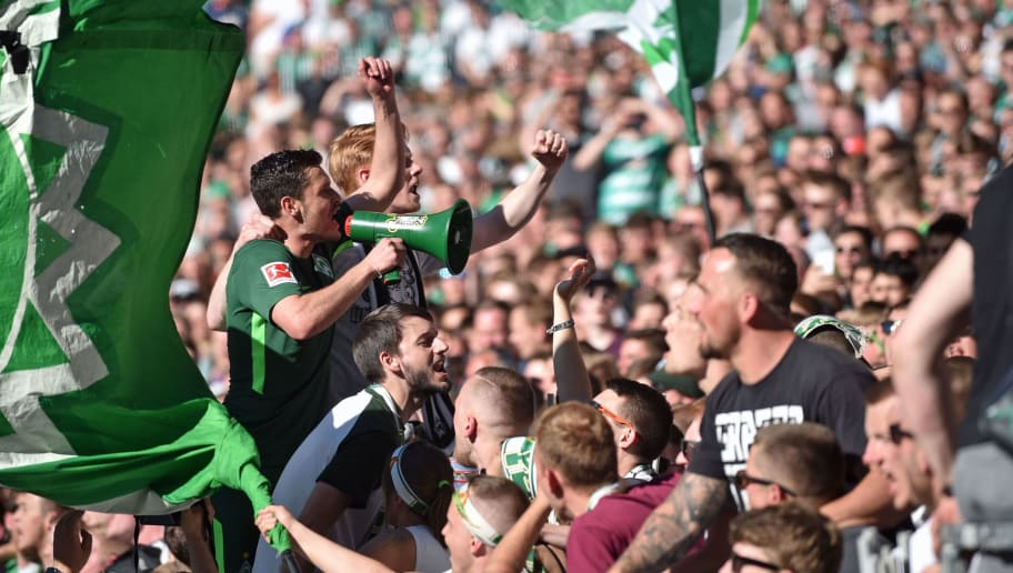 BREMEN, GERMANY - MAY 05: Zlatko Junuzovic (L) of Bremen celebrates with the Bremen supporters during the Bundesliga match between SV Werder Bremen and Bayer 04 Leverkusen at Weserstadion on May 5, 2018 in Bremen, Germany. (Photo by Thomas Starke/Bongarts/Getty Images)