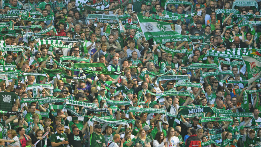 BREMEN, GERMANY - MAY 05: Supporters of Bremen cheer their team during the Bundesliga match between SV Werder Bremen and Bayer 04 Leverkusen at Weserstadion on May 5, 2018 in Bremen, Germany. (Photo by Thomas Starke/Bongarts/Getty Images)