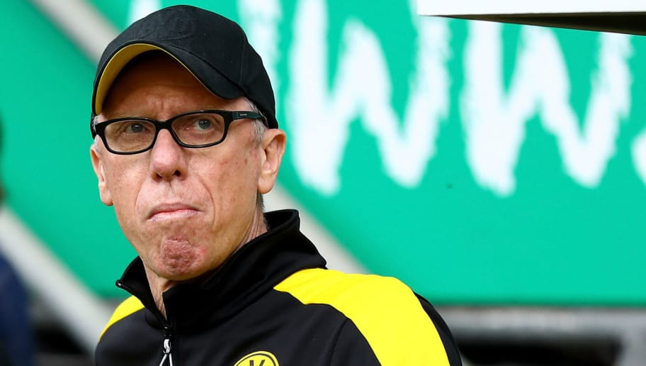 BREMEN, GERMANY - APRIL 29:  Peter Stoeger, head coach of Dortmund looks on before the Bundesliga match between SV Werder Bremen and Borussia Dortmund at Weserstadion on April 29, 2018 in Bremen, Germany.  (Photo by Martin Rose/Bongarts/Getty Images)