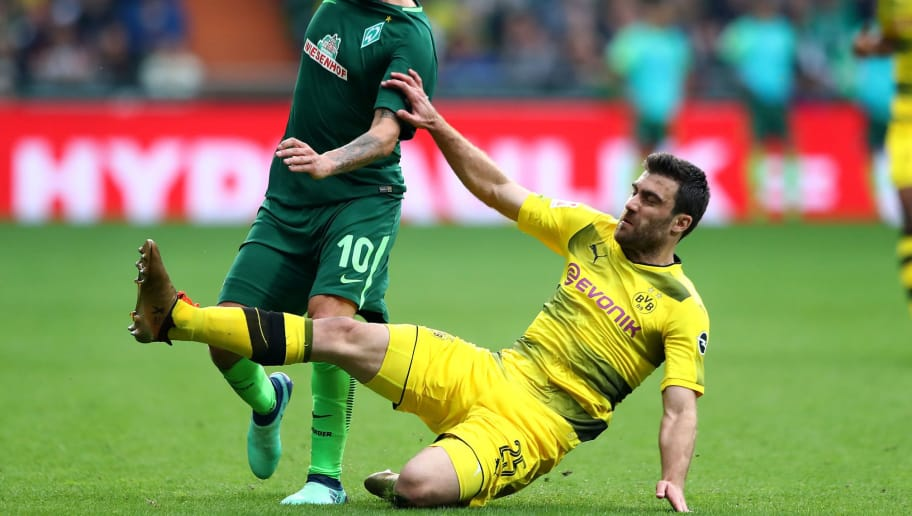 BREMEN, GERMANY - APRIL 29:  Max Kruse (L) of Bremen and Sokratis of Dortmund battle for the ball during the Bundesliga match between SV Werder Bremen and Borussia Dortmund at Weserstadion on April 29, 2018 in Bremen, Germany.  (Photo by Martin Rose/Bongarts/Getty Images)
