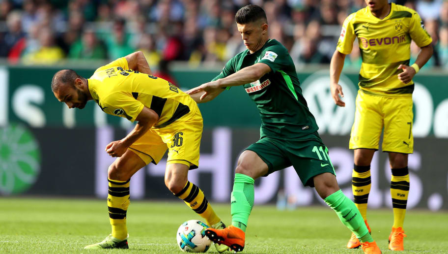 BREMEN, GERMANY - APRIL 29:  Milot Rashica (R) of Bremen and Oemer Toprak of Dortmund battle for the ball during the Bundesliga match between SV Werder Bremen and Borussia Dortmund at Weserstadion on April 29, 2018 in Bremen, Germany.  (Photo by Martin Rose/Bongarts/Getty Images)
