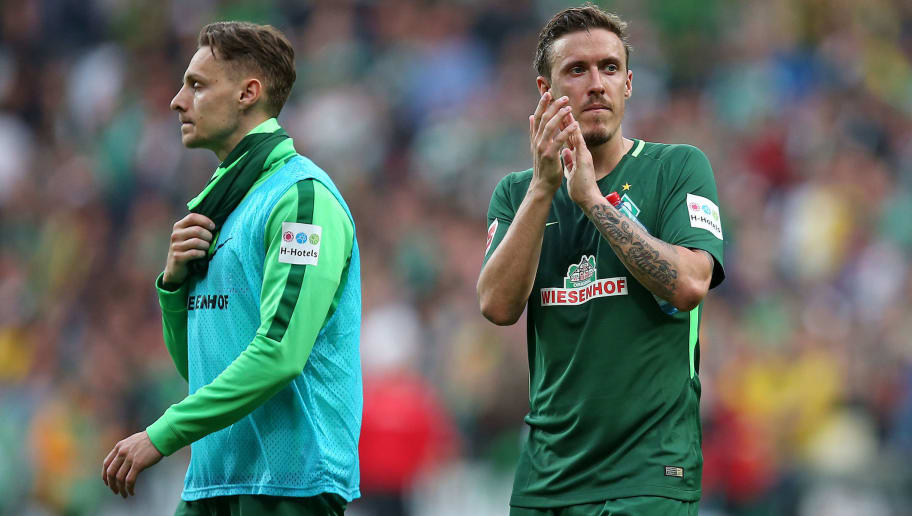 BREMEN, GERMANY - APRIL 29: Robert Bauer of Bremen and Max Kruse of Bremen gesture after the Bundesliga match between SV Werder Bremen and Borussia Dortmund at Weserstadion on April 29, 2018 in Bremen, Germany. (Photo by TF-Images/Getty Images)