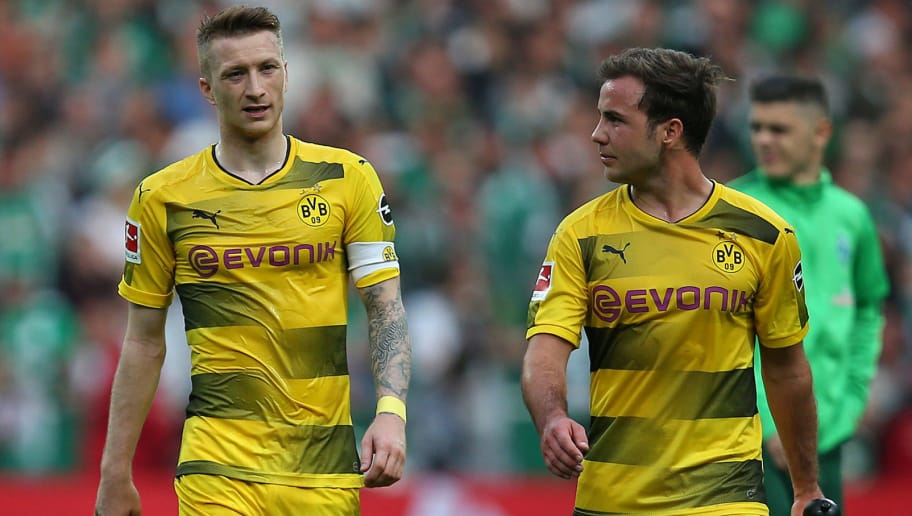 BREMEN, GERMANY - APRIL 29: Marco Reus of Dortmund and Mario Goetze of Dortmund look on after the Bundesliga match between SV Werder Bremen and Borussia Dortmund at Weserstadion on April 29, 2018 in Bremen, Germany. (Photo by TF-Images/Getty Images)