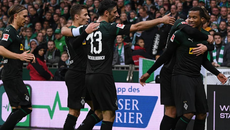 BREMEN, GERMANY - NOVEMBER 10: Alassane Plea (R) of  Borussia Moenchengladbach celebrates with teammates after scoring his team's first goal during the Bundesliga match between SV Werder Bremen and Borussia Moenchengladbach at Weserstadion on November 10, 2018 in Bremen, Germany. (Photo by Oliver Hardt/Bongarts/Getty Images)