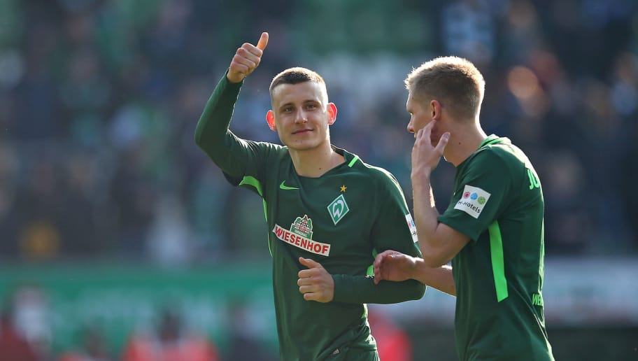 BREMEN, GERMANY - APRIL 01: Maximilian Eggestein of Bremen and Aron Johannsson of Bremen celebrate after winning the Bundesliga match between Werder Bremen and Eintracht Frankfurt at Weserstadion on April 01, 2018 in Bremen, Germany. (Photo by TF-Images/Getty Images)