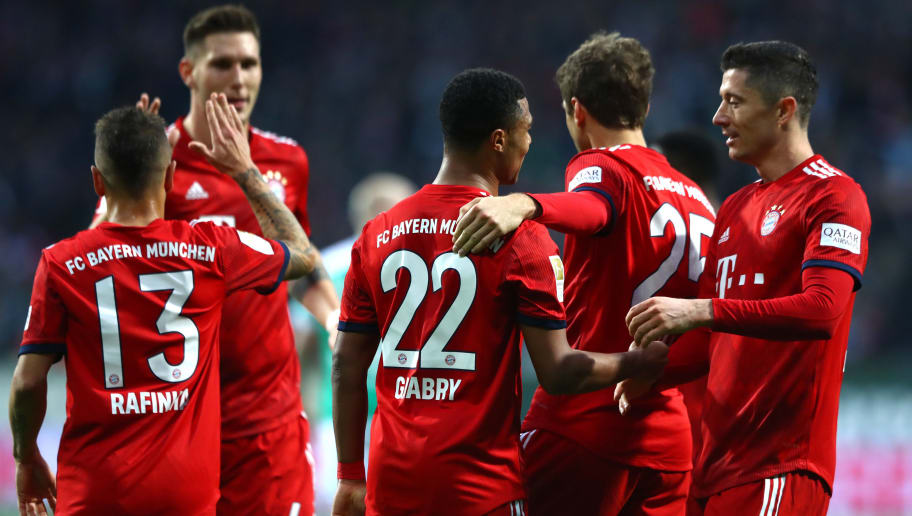 BREMEN, GERMANY - DECEMBER 01:  Serge Gnabry of Bayern Munich celebrates with teammates after scoring his team's first goal during the Bundesliga match between SV Werder Bremen and FC Bayern Muenchen at Weserstadion on December 1, 2018 in Bremen, Germany.  (Photo by Martin Rose/Bongarts/Getty Images)