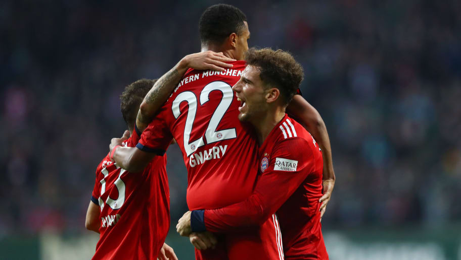 BREMEN, GERMANY - DECEMBER 01:  Serge Gnabry of Bayern Munich celebrates after scoring his team's first goal with Rafinha and Leon Goretzka of Bayern Munich during the Bundesliga match between SV Werder Bremen and FC Bayern Muenchen at Weserstadion on December 1, 2018 in Bremen, Germany.  (Photo by Martin Rose/Bongarts/Getty Images)