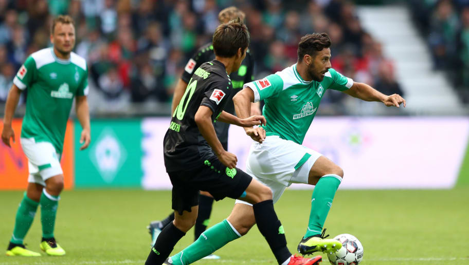 BREMEN, GERMANY - AUGUST 25:  Claudio Pizarro of Werder Bremen controls the ball as Daniel Baier of Augsburg during the Bundesliga match between SV Werder Bremen and Hannover 96 at Weserstadion on August 25, 2018 in Bremen, Germany.  (Photo by Martin Rose/Bongarts/Getty Images)