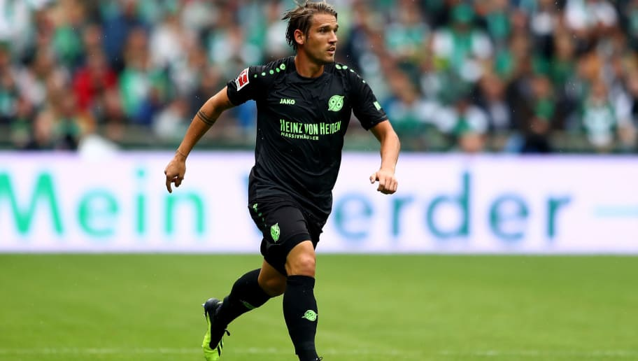 BREMEN, GERMANY - AUGUST 25:  Oliver Sorg of Hannover runs with the ball during the Bundesliga match between SV Werder Bremen and Hannover 96 at Weserstadion on August 25, 2018 in Bremen, Germany.  (Photo by Martin Rose/Bongarts/Getty Images)