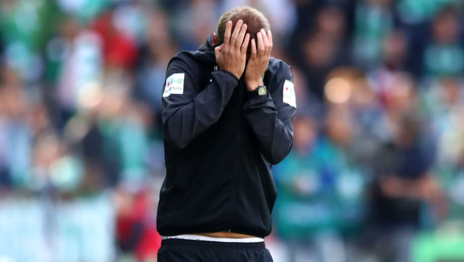 BREMEN, GERMANY - AUGUST 25:  Florian Kohfeldt, Manager of Werder Bremen reacts during the Bundesliga match between SV Werder Bremen and Hannover 96 at Weserstadion on August 25, 2018 in Bremen, Germany.  (Photo by Martin Rose/Bongarts/Getty Images)