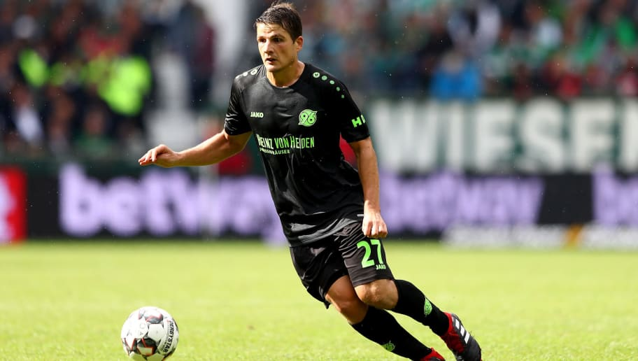 BREMEN, GERMANY - AUGUST 25:  Pirmin Schwegler of Hannover runs with the ball during the Bundesliga match between SV Werder Bremen and Hannover 96 at Weserstadion on August 25, 2018 in Bremen, Germany.  (Photo by Martin Rose/Bongarts/Getty Images)