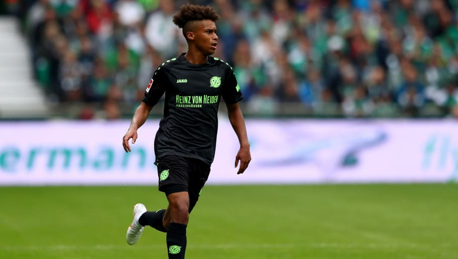 BREMEN, GERMANY - AUGUST 25: Linton Maina of Hannover runs with the ball during the Bundesliga match between SV Werder Bremen and Hannover 96 at Weserstadion on August 25, 2018 in Bremen, Germany.  (Photo by Martin Rose/Bongarts/Getty Images)