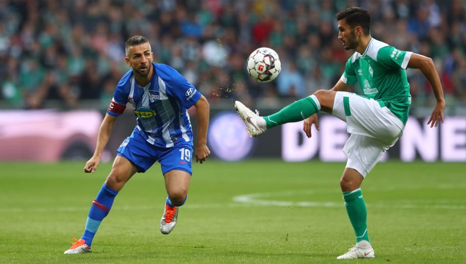 BREMEN, GERMANY - SEPTEMBER 25:  Vedad Ibisevic of Hertha BSC and Nuri Sahin of Werder Bremen in action during the Bundesliga match between SV Werder Bremen and Hertha BSC at Weserstadion on September 25, 2018 in Bremen, Germany.  (Photo by Martin Rose/Bongarts/Getty Images)