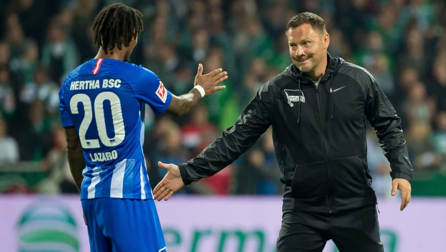 BREMEN, GERMANY - SEPTEMBER 25: Valentino Lazaro of Hertha BSC and Head coach Pal Dardai of Hertha BSC slap hands after the Bundesliga match between SV Werder Bremen and Hertha BSC at Weserstadion on September 25, 2018 in Bremen, Germany. (Photo by TF-Images/Getty Images)