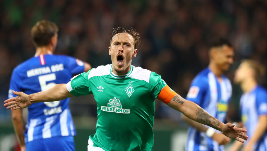 BREMEN, GERMANY - SEPTEMBER 25:  Max Kruse of Werder Bremen celebrates after scoring a penalty and his team's third goal during the Bundesliga match between SV Werder Bremen and Hertha BSC at Weserstadion on September 25, 2018 in Bremen, Germany.  (Photo by Martin Rose/Bongarts/Getty Images)