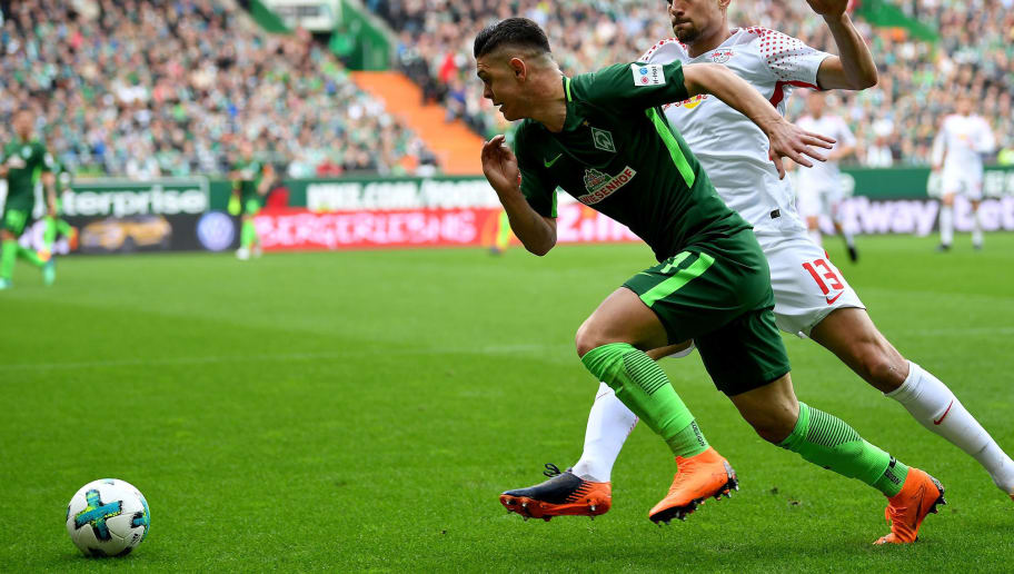 BREMEN, GERMANY - APRIL 15: Milot Rashica (L) of Bremen and Stefan Ilsanker of Leipzig battle for the ball during the Bundesliga match between SV Werder Bremen and RB Leipzig at Weserstadion on April 15, 2018 in Bremen, Germany.  (Photo by Stuart Franklin/Bongarts/Getty Images)