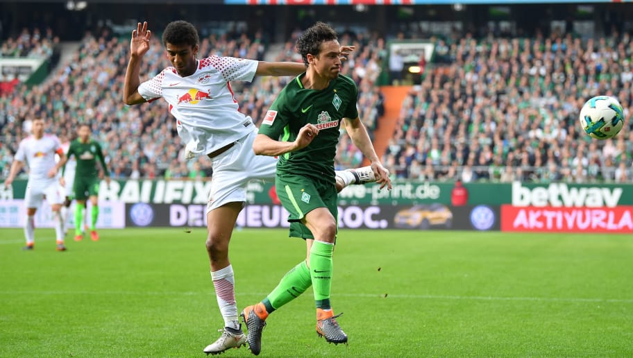 BREMEN, GERMANY - APRIL 15:  Thomas Delaney  of Bremen is challenged by Bernardo of Leipzig during the Bundesliga match between SV Werder Bremen and RB Leipzig at Weserstadion on April 15, 2018 in Bremen, Germany.  (Photo by Stuart Franklin/Bongarts/Getty Images)