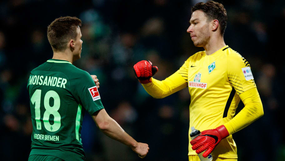 BREMEN, GERMANY - JANUARY 13: Niclas Moisander of Bremen celebrates with goalkeeper Jiri Pavlenka of Bremen after the Bundesliga match between SV Werder Bremen and TSG 1899 Hoffenheim at Weserstadion on January 13, 2018 in Bremen, Germany.  (Photo by Lars Baron/Bongarts/Getty Images)
