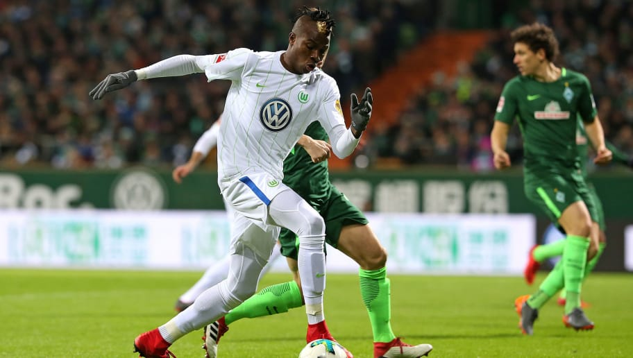 BREMEN, GERMANY - FEBRUARY 11: 'nVictor Osimhen of Wolfsburg and 'nNiklas Moisander of Werder Bremen 'nbattle for the ball during the Bundesliga match between SV Werder Bremen and VfL Wolfsburg at Weserstadion on February 11, 2018 in Bremen, Germany. (Photo by TF-Images/TF-Images via Getty Images)