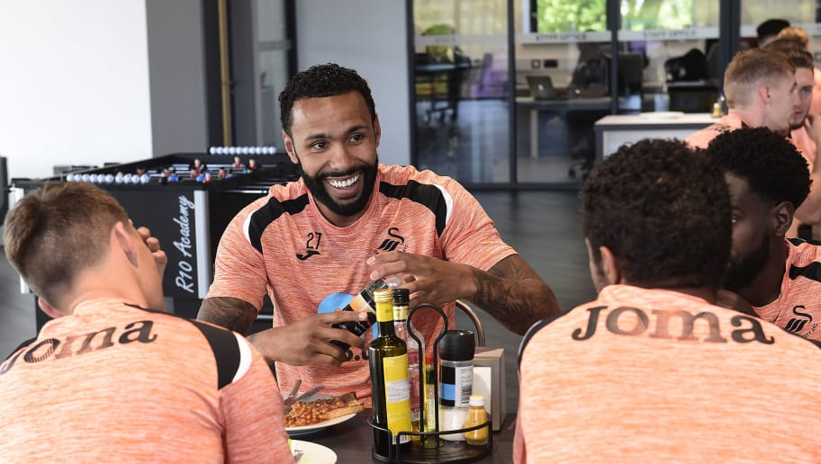 SWANSEA, WALES - JULY 02: Kyle Bartley has lunch with team mates during the Swansea City Players Return to Pre-Season Training at The Fairwood Training Ground on July 02, 2018 in Swansea, Wales. (Photo by Athena Pictures/Getty Images)