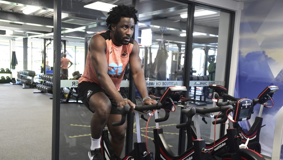 SWANSEA, WALES - JULY 02: Wilfried Bony exercises in the gym during the Swansea City Players Return to Pre-Season Training at The Fairwood Training Ground on July 02, 2018 in Swansea, Wales. (Photo by Athena Pictures/Getty Images)