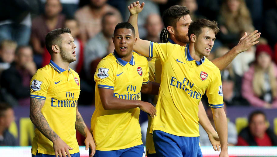 SWANSEA, WALES - SEPTEMBER 28:  Serge Gnabry of Arsenal celebrates after scoring their first goal during the Barclays Premier League match between Swansea City and Arsenal at Liberty Stadium on September 28, 2013 in Swansea, Wales.  (Photo by Scott Heavey/Getty Images)