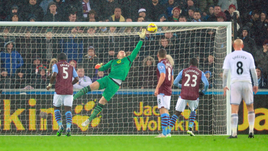 SWANSEA, WALES - DECEMBER 26:  Villa goalkeeper Brad Guzan is beaten by a free kick from Gylfi Sigurdsson (not pictured) for the first goal during the Barclays Premier League match between Swansea City and Aston Villa at Liberty Stadium on December 26, 2014 in Swansea, Wales.  (Photo by Stu Forster/Getty Images)