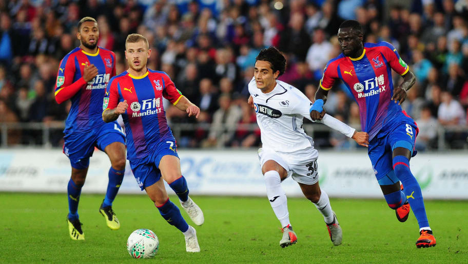 SWANSEA, WALES - AUGUST 28: Yan Dhanda of Swansea City battles with Max Meyer (L) and Cheikhou Kouate (R) of Crystal Palace during the Carabao Cup Second Round match between Swansea City and Crystal Palace at Liberty Stadium on August 28, 2018 in Swansea, Wales. (Photo by Athena Pictures/Getty Images)