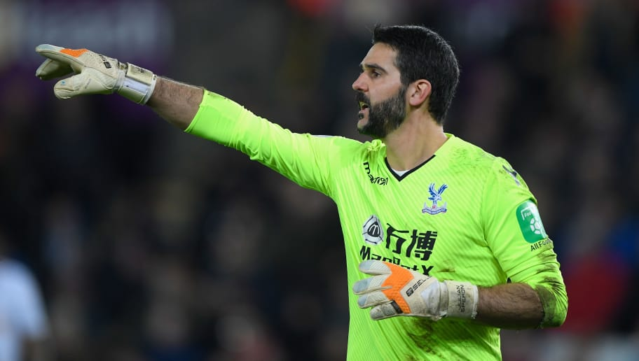 SWANSEA, WALES - DECEMBER 23:  Palace goalkeeper Julian Speroni in action during the Premier League match between Swansea City and Crystal Palace at Liberty Stadium on December 23, 2017 in Swansea, Wales.  (Photo by Stu Forster/Getty Images)