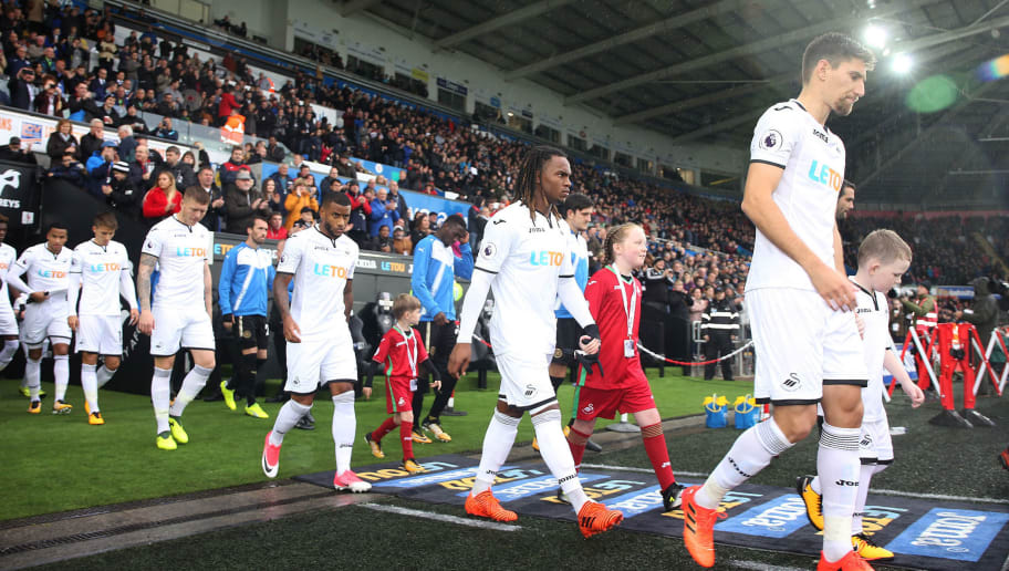 SWANSEA, WALES - OCTOBER 21: Federico Fernandez of Swansea City, Renato Sanches, Luciano Narsingh walk out of the tunnel prior to kick off of the Premier League match between Swansea City and Leicester City at The Liberty Stadium on October 21, 2017 in Swansea, Wales. (Photo by Athena Pictures/Getty Images)
