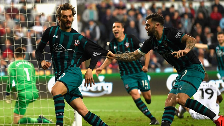 SWANSEA, WALES - MAY 08:  Manolo Gabbiadini of Southampton celebrates with Charlie Austin after he scores his sides first goal during the Premier League match between Swansea City and Southampton at Liberty Stadium on May 8, 2018 in Swansea, Wales.  (Photo by Stu Forster/Getty Images)