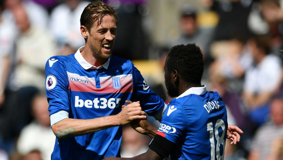 SWANSEA, WALES - MAY 13:  Peter Crouch of Stoke City celebrates with Mame Biram Diouf of Stoke City after scoring his sides second goal during the Premier League match between Swansea City and Stoke City at Liberty Stadium on May 13, 2018 in Swansea, Wales.  (Photo by Dan Mullan/Getty Images)