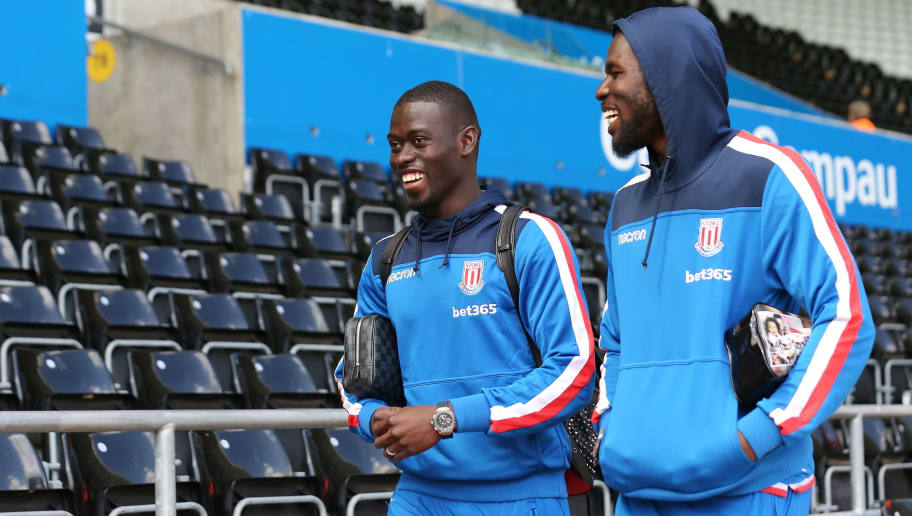 SWANSEA, WALES - MAY 13: Mame Biram Diouf of Stoke City and Badou Ndiaye of Stoke City during the Premier League match between Swansea City and Stoke City at Liberty Stadium on May 13, 2018 in Swansea, Wales. (Photo by James Williamson - AMA/Getty Images)