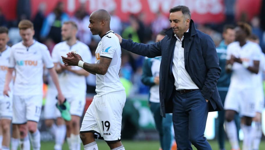 SWANSEA, WALES - MAY 13: Andre Ayew of Swansea City and Swansea City manager Carlos Carvalhal during the Premier League match between Swansea City and Stoke City at Liberty Stadium on May 13, 2018 in Swansea, Wales. (Photo by James Williamson - AMA/Getty Images)