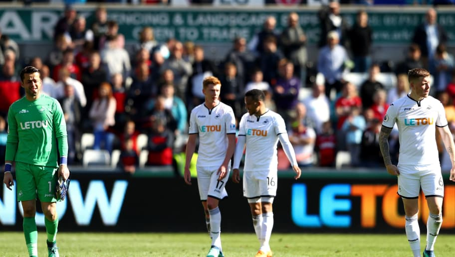 SWANSEA, WALES - MAY 13:  Lukasz Fabianski and Alfie Mawson of Swansea City applaud fans during the Premier League match between Swansea City and Stoke City at Liberty Stadium on May 13, 2018 in Swansea, Wales.  (Photo by Michael Steele/Getty Images)