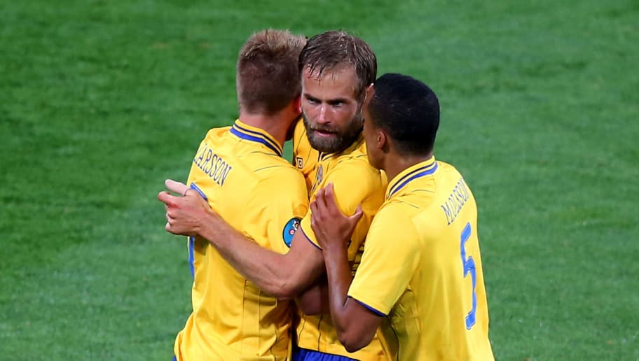 KIEV, UKRAINE - JUNE 15:  Olof Mellberg of Sweden celebrates scoring with  Martin Olsson  and Sebastian Larsson of Sweden during the UEFA EURO 2012 group D match between Sweden and England at The Olympic Stadium on June 15, 2012 in Kiev, Ukraine.  (Photo by Martin Rose/Getty Images)
