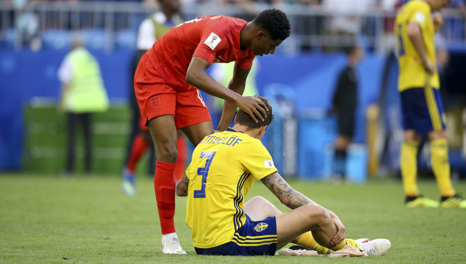 SAMARA, RUSSIA - JULY 7: Marcus Rashford of England consoles Manchester United teammate Victor Lindelof of Sweden following the 2018 FIFA World Cup Russia Quarter Final match between Sweden and England at Samara Arena on July 7, 2018 in Samara, Russia. (Photo by Jean Catuffe/Getty Images)
