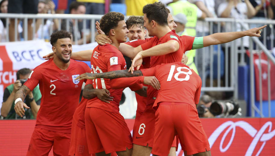SAMARA, RUSSIA - JULY 7: Dele Alli of England celebrates his goal with Kyle Walker, John Stones, Harry Maguire during the 2018 FIFA World Cup Russia Quarter Final match between Sweden and England at Samara Arena on July 7, 2018 in Samara, Russia. (Photo by Jean Catuffe/Getty Images)