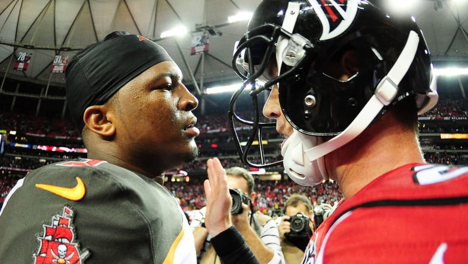 ATLANTA, GA - NOVEMBER 01:  Jameis Winston #3 of the Tampa Bay Buccaneers talks to  Matt Ryan #2 of the Atlanta Falcons after winning in overtime at the Georgia Dome on November 1, 2015 in Atlanta, Georgia.  (Photo by Scott Cunningham/Getty Images)