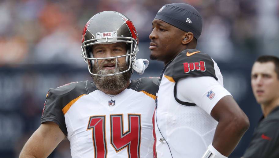 CHICAGO, IL - SEPTEMBER 30: Ryan Fitzpatrick #14 of the Tampa Bay Buccaneers looks on while standing next to Jameis Winston #3 on the sideline during the game against the Chicago Bears at Soldier Field on September 30, 2018 in Chicago, Illinois. The Bears won 48-10. (Photo by Joe Robbins/Getty Images)
