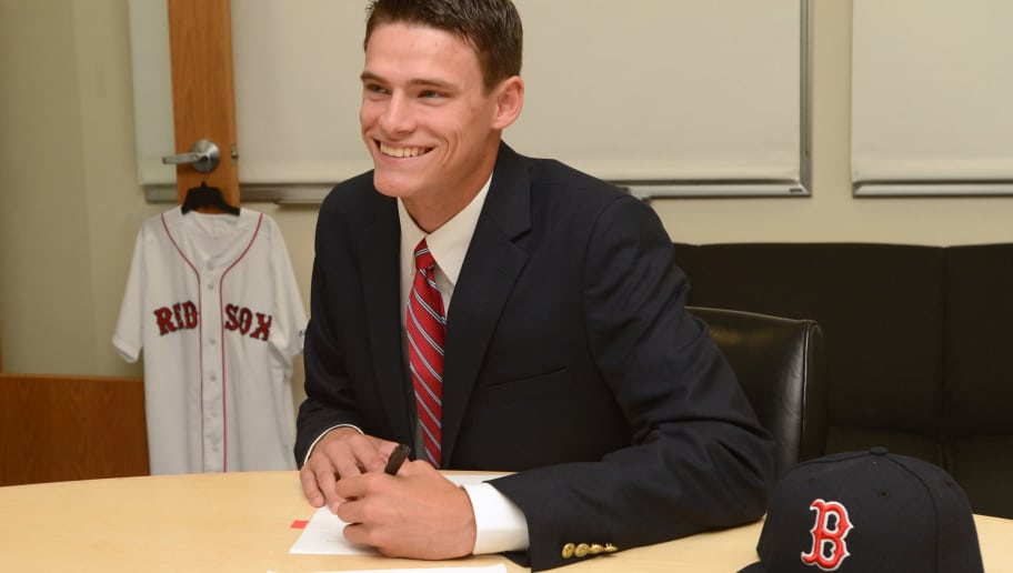 BOSTON, MA - JUNE 19: Boston Red Sox 2013 first round pick Trey Ball, 18, of New Castle Chrysler High School in Indiana smiles as he signs a contract with the team during a visit on June 19, 2013 to Fenway Park in Boston, Massachusetts. (Photo by Michael Ivins/Boston Red Sox/Getty Images)