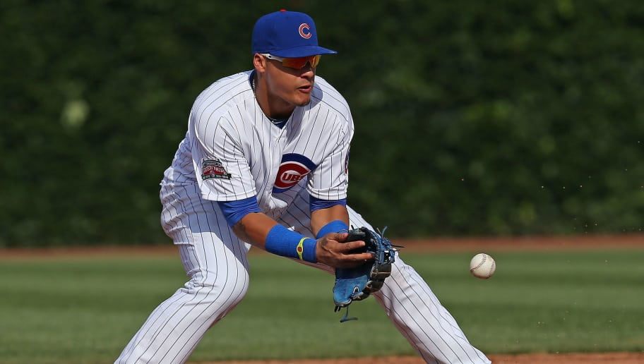CHICAGO, IL - AUGUST 09:  Javy Baez #9 of the Chicago Cubs makes a fielding error against the Tampa Bay Rays at Wrigley Field on August 9, 2014 in Chicago, Illinois.  (Photo by Jonathan Daniel/Getty Images)